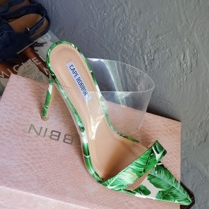 Exotic green pointed open toe sandal.